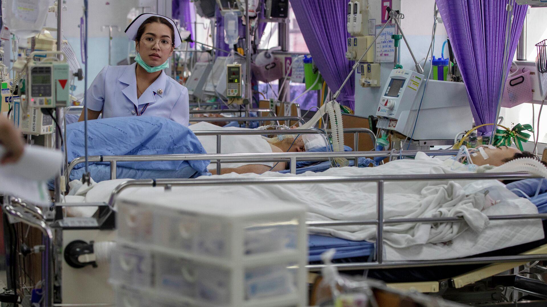 Медсестра в отделении скорой помощи с жертвами массовой стрельбы в Корате, Накхонратчасима, Таиланд. 9 февраля 2020 - РИА Новости, 1920, 29.08.2021