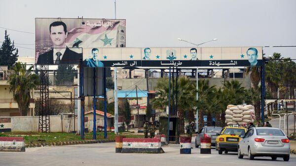 Блокпост сирийской армии на дороге в городе Мааррат-эн-Нууман