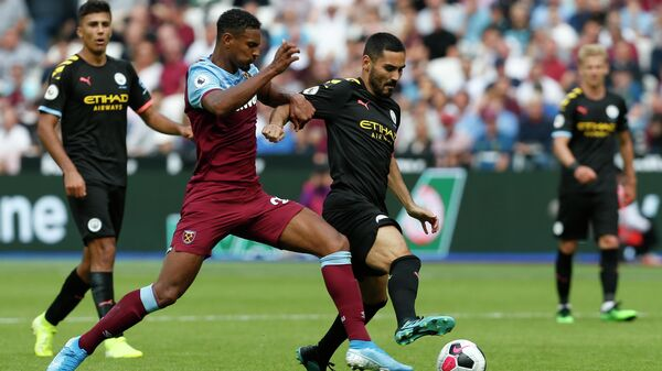 West Ham United's French striker Sebastien Haller (L) battles with Manchester City's Algerian midfielder Riyad Mahrez (R) during the English Premier League football match between West Ham United and Manchester City at The London Stadium, in east London on August 10, 2019. (Photo by Ian KINGTON / AFP) / RESTRICTED TO EDITORIAL USE. No use with unauthorized audio, video, data, fixture lists, club/league logos or 'live' services. Online in-match use limited to 120 images. An additional 40 images may be used in extra time. No video emulation. Social media in-match use limited to 120 images. An additional 40 images may be used in extra time. No use in betting publications, games or single club/league/player publications. /