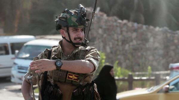 Военнослужащий на улице Багдада