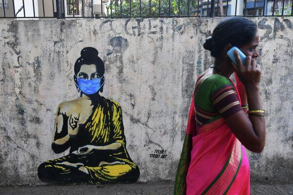 Граффити на стене в Мумбаи