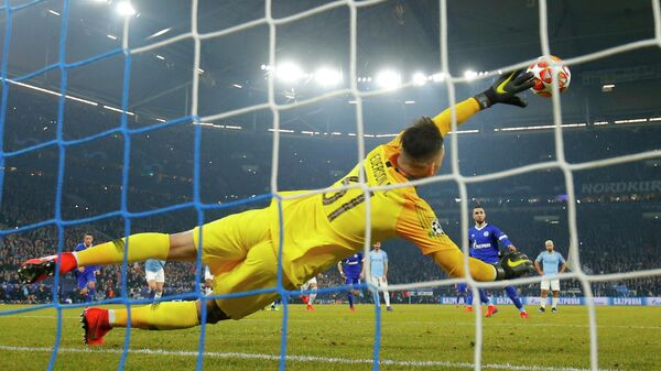 Schalke's Algerian midfielder Nabil Bentaleb shoots a penalty kick to score in front of Manchester City's Brazilian goalkeeper Ederson during the UEFA Champions League round of 16 first leg football match between Schalke 04 and Manchester City  on February 20, 2019 in Gelsenkirchen, Germany. (Photo by Odd ANDERSEN / AFP)