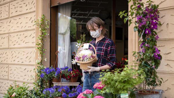 Продавец цветов на одной из улиц в Турине