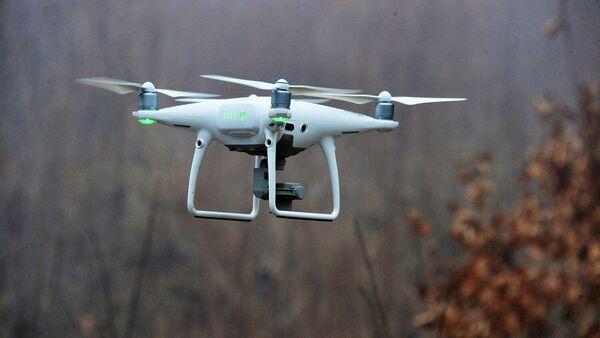 Квадрокоптер во время съемки