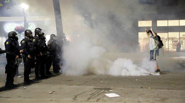 Акция протеста в городе Окленд в штате Калифорния, США