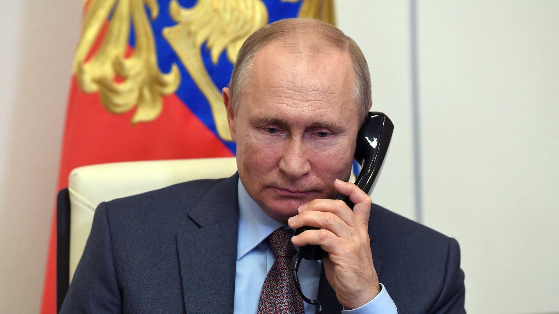 Президент РФ Владимир Путин во время встречи в режиме видеоконференции с председателем правительства РФ Михаилом Мишустиным - РИА Новости, 1920, 25.01.2021