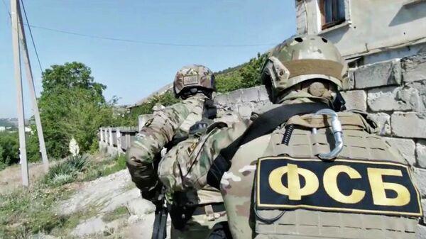 Кадр видео спецоперации по задержанию подозреваемых в подготовке теракта в Симферополе