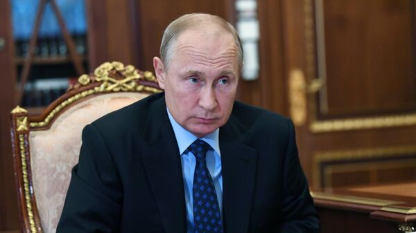 Президент РФ Владимир Путин во время встречи с генеральным директором государственной корпорации по атомной энергии Росатом Алексеем Лихачевым
