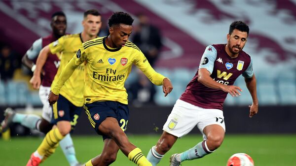 Arsenal's English midfielder Joe Willock (C) and Aston Villa's Egyptian midfielder Trezeguet compete during the English Premier League football match between Aston Villa and Arsenal at Villa Park in Birmingham, central England on July 21, 2020. (Photo by PETER POWELL / POOL / AFP) / RESTRICTED TO EDITORIAL USE. No use with unauthorized audio, video, data, fixture lists, club/league logos or 'live' services. Online in-match use limited to 120 images. An additional 40 images may be used in extra time. No video emulation. Social media in-match use limited to 120 images. An additional 40 images may be used in extra time. No use in betting publications, games or single club/league/player publications. /