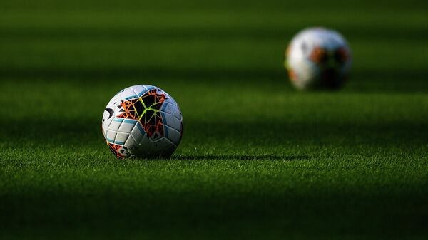 Balls are pictured on the pitch prior to the Italian Serie A football match Inter vs Brescia played behind closed doors on July 1, 2020 at the Giuseppe-Meazza San Siro stadium in Milan, as the country eases its lockdown aimed at curbing the spread of the COVID-19 infection, caused by the novel coronavirus. (Photo by Miguel MEDINA / AFP)