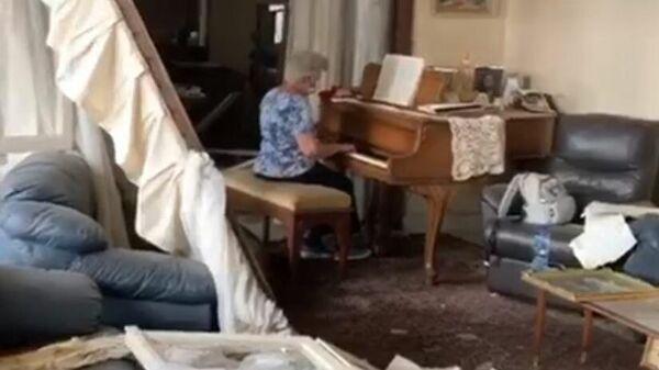Стоп-кадр видео из Facebook-аккаунта May-Lee Melki