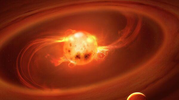 Так в представлении художника потоки газа достигают поверхности молодой звезды по силовым линиям магнитного поля
