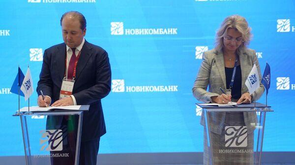 Подписание соглашения между Новикомбанком и Межгосударственной корпорацией развития