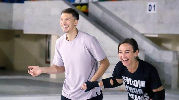 Дмитрий Соловьев и Ольга Бузова на тренировке.