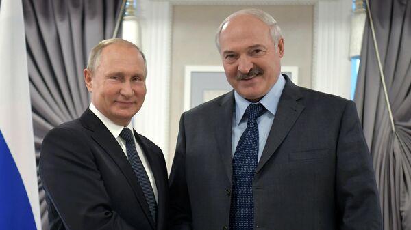 Президент РФ Владимир Путин и президент Республики Беларусь Александр Лукашенко