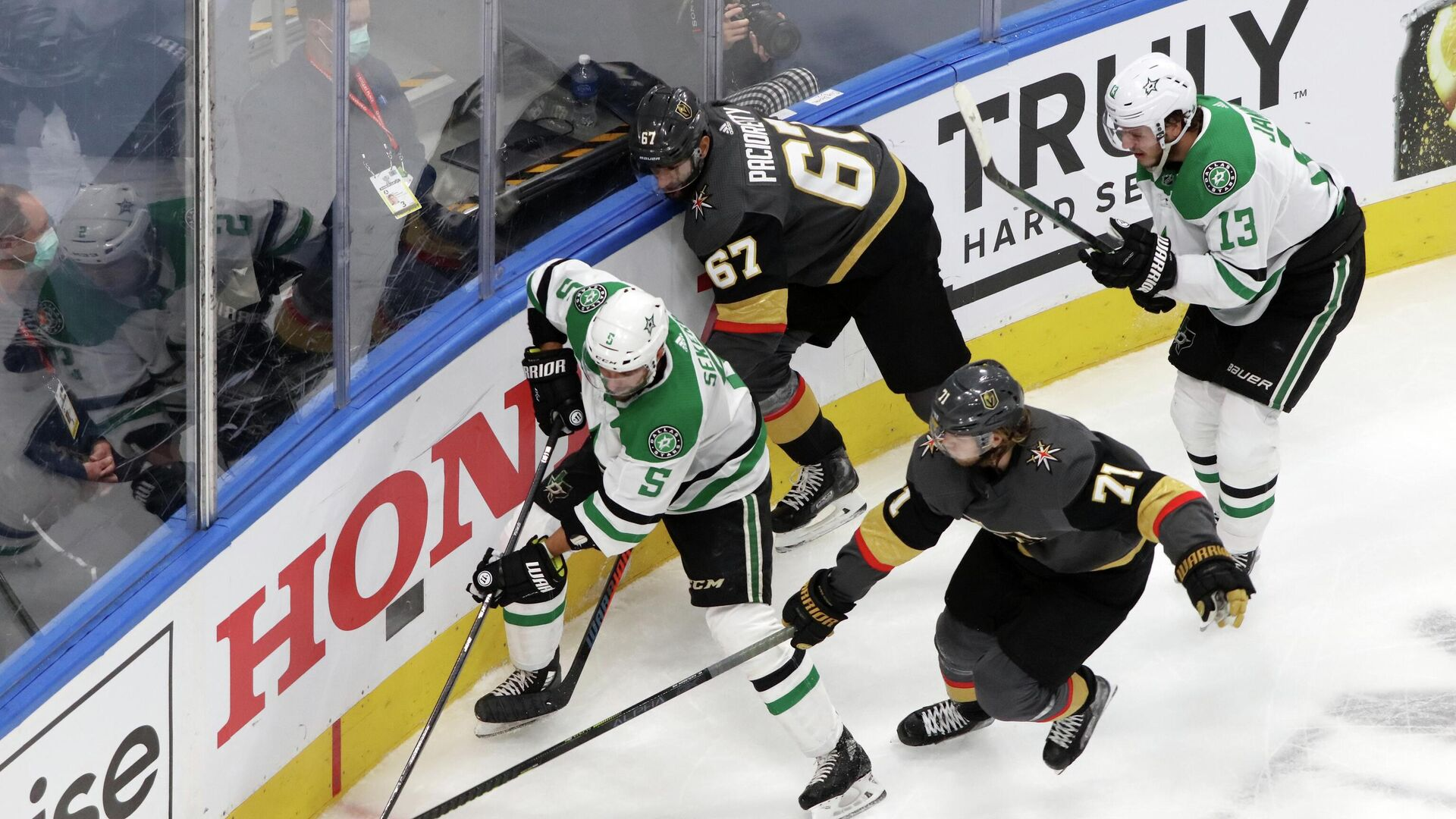 Sep 14, 2020; Edmonton, Alberta, CAN; Vegas Golden Knights center William Karlsson (71) reaches for the puck on Dallas Stars defenseman Andrej Sekera (5) during the second period in game five of the second round of the 2020 Stanley Cup Playoffs at Rogers Place. Mandatory Credit: Gerry Thomas-USA TODAY Sports - РИА Новости, 1920, 15.09.2020