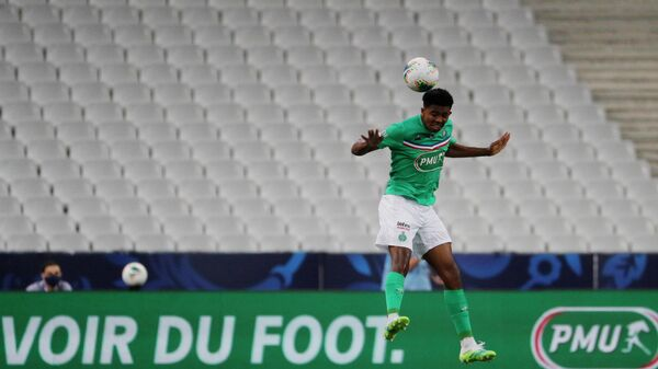 Saint-Etienne's French defender Wesley Fofana jumps for the ball  during the French Cup final football match between Paris Saint-Germain (PSG) and Saint-Etienne (ASSE) on July 24, 2020, at the Stade de France in Saint-Denis, outside Paris. (Photo by GEOFFROY VAN DER HASSELT / AFP)