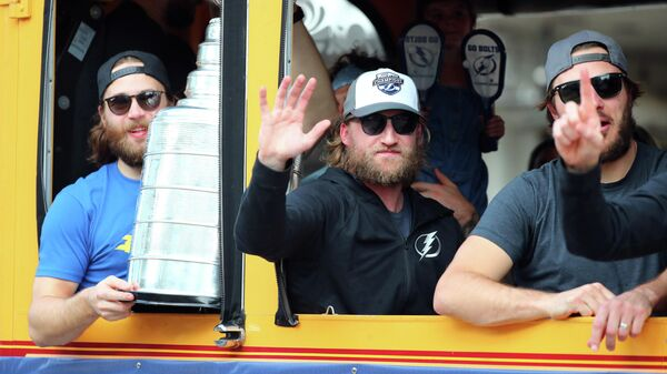 Sep 29, 2020; Tampa, FL, USA; Tampa Bay Lightning center Steven Stamkos (91) and defenseman Victor Hedman (77) and teammates arrive on trollies as they return from Edmonton with the Stanley Cup at Amalie Arena. The Tampa Bay Lightning defeated the Dallas Stars four games to two to win the 2020 Stanley Cup. Mandatory Credit: Kim Klement-USA TODAY Sports
