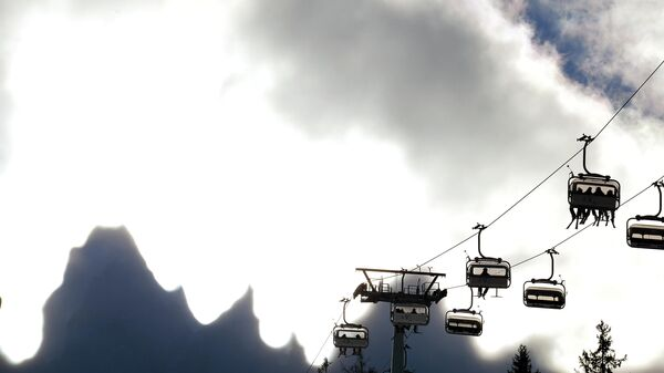 A picture shows the Dolomiti mountains behind clouds during the Freestyle world cup Ski Cross in San Candido on December 21, 2013.  AFP PHOTO/ VINCENZO PINTO (Photo by VINCENZO PINTO / AFP)