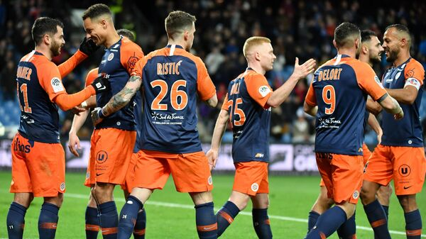 Montpellier's players react after scoring a goal during the French L1 football match between Montpellier and Strasbourg at the Mosson stadium in Montpellier, southern France, on February 29, 2020. (Photo by Pascal GUYOT / AFP)