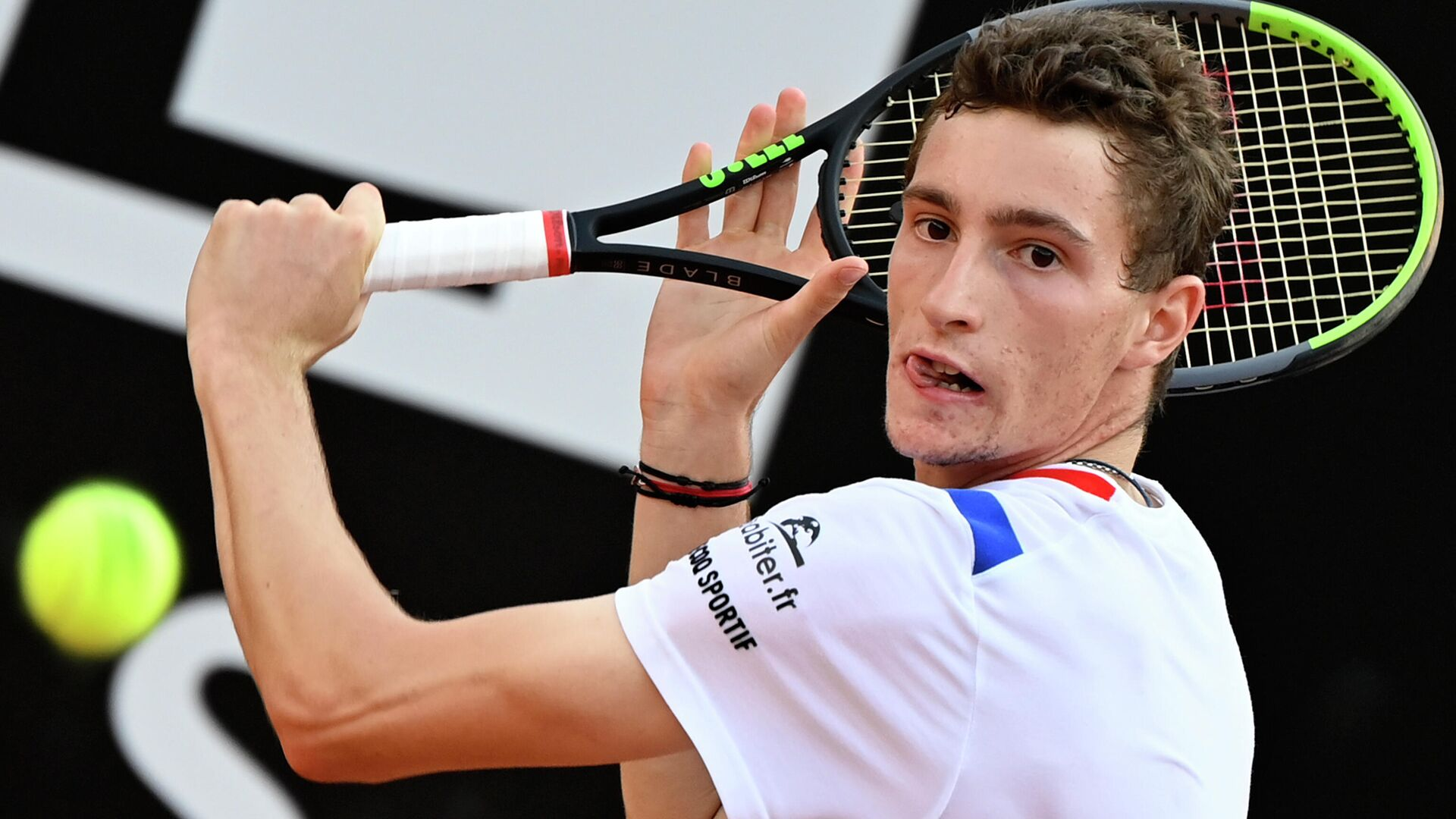 France's Ugo Humbert plays a backhand to Italy's Fabio Fognini on day four of the Men's Italian Open at Foro Italico on September 17, 2020 in Rome, Italy. (Photo by Riccardo Antimiani / POOL / AFP) - РИА Новости, 1920, 24.10.2020