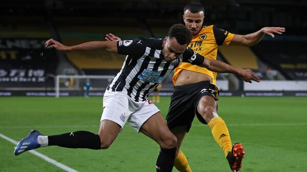 Wolverhampton Wanderers' Moroccan midfielder Romain Saiss (R) vies with Newcastle United's English midfielder Jacob Murphy during the English Premier League football match between Wolverhampton Wanderers and Newcastle United at the Molineux stadium in Wolverhampton, central England on October 25, 2020. (Photo by Nick Potts / POOL / AFP) / RESTRICTED TO EDITORIAL USE. No use with unauthorized audio, video, data, fixture lists, club/league logos or 'live' services. Online in-match use limited to 120 images. An additional 40 images may be used in extra time. No video emulation. Social media in-match use limited to 120 images. An additional 40 images may be used in extra time. No use in betting publications, games or single club/league/player publications. /