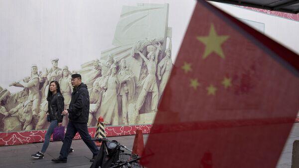 Покупатели в торговом центре в Пекине, КНР