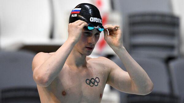 Григорий Тарасевич после финального заплыва среди мужчин на дистанции 50 метров на спине на чемпионате России по плаванию в Казани.