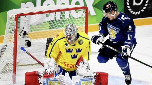 Ice Hockey - Karjala Cup - Finland v Sweden - Hartwall Arena, Helsinki, Finland - November 8, 2020   Finland's Eemeli Suomi in action with Sweden's Niklas Rubin Vesa Moilanen/Lehtikuva via REUTERS  ATTENTION EDITORS - THIS IMAGE WAS PROVIDED BY A THIRD PARTY. NO THIRD PARTY SALES. NOT FOR USE BY REUTERS THIRD PARTY DISTRIBUTORS. FINLAND OUT. NO COMMERCIAL OR EDITORIAL SALES IN FINLAND.