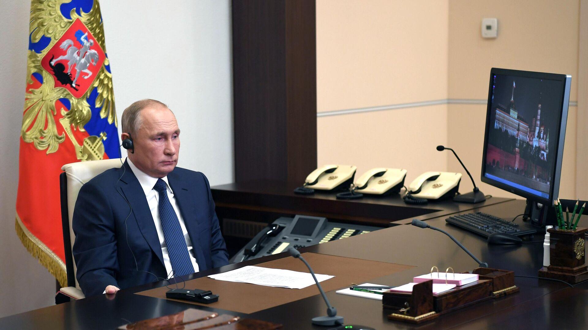 Президент РФ Владимир Путин во время встречи в режиме телемоста с президентом Сирии Башаром Асадом - РИА Новости, 1920, 15.09.2021