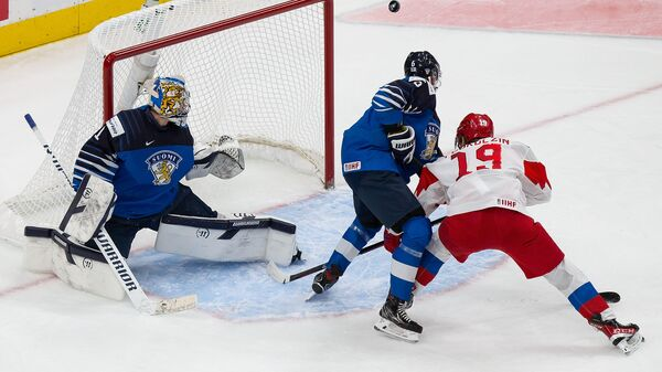 EDMONTON, AB - JANUARY 05: Vasili Podkolzin #19 of Russia skates against goaltender Kari Piiroinen #1 and Eemil Viro #6 of Finland during the 2021 IIHF World Junior Championship bronze medal game at Rogers Place on January 5, 2021 in Edmonton, Canada.   Codie McLachlan/Getty Images/AFP