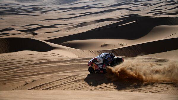 Катарский автогонщик Нассер Аль-Аттия