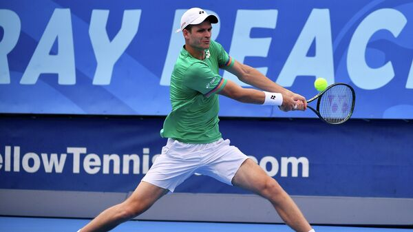 DELRAY BEACH, FLORIDA - JANUARY 11: Hubert Hurkacz of Poland plays a backhand against Roberto Quiroz of Ecuador (not pictured) during the Quarterfinals of the Delray Beach Open by Vitacost.com at Delray Beach Tennis Center on January 11, 2021 in Delray Beach, Florida.   Mark Brown/Getty Images/AFP