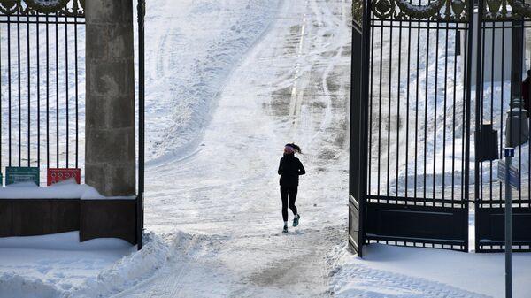 Девушка во время пробежки в Центральном парке