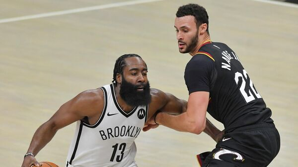 CLEVELAND, OHIO - JANUARY 20: James Harden #13 of the Brooklyn Nets drives around Larry Nance Jr. #22 of the Cleveland Cavaliers during the third quarter at Rocket Mortgage Fieldhouse on January 20, 2021 in Cleveland, Ohio. NOTE TO USER: User expressly acknowledges and agrees that, by downloading and/or using this photograph, user is consenting to the terms and conditions of the Getty Images License Agreement.   Jason Miller/Getty Images/AFP