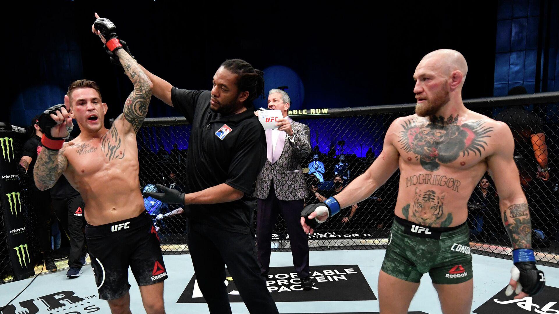 Дастин Порье (слева) и Конор Макгрегор после поединка на турнире UFC 257 - РИА Новости, 1920, 24.01.2021