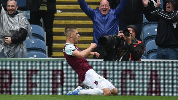 Burnley's Icelandic midfielder Johann Berg Gudmundsson celebrates scoring their third goal during the English Premier League football match between Burnley and Southampton at Turf Moor in Burnley, north west England on August 10, 2019. (Photo by Oli SCARFF / AFP) / RESTRICTED TO EDITORIAL USE. No use with unauthorized audio, video, data, fixture lists, club/league logos or 'live' services. Online in-match use limited to 120 images. An additional 40 images may be used in extra time. No video emulation. Social media in-match use limited to 120 images. An additional 40 images may be used in extra time. No use in betting publications, games or single club/league/player publications. /