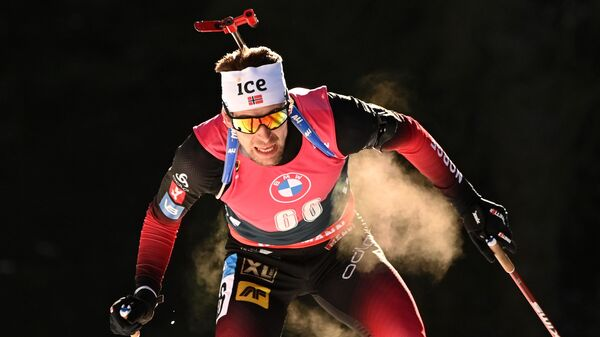 Стурла Холм Легрейд (Норвегия) на дистанции индивидуальной гонки среди мужчин на чемпионате мира по биатлону 2021 в словенской Поклюке.