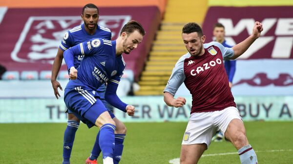 Leicester City's English midfielder James Maddison (L) vies with Aston Villa's Scottish midfielder John McGinn (R) during the English Premier League football match between Aston Villa and Leicester City at Villa Park in Birmingham, central England on February 21, 2021. (Photo by Rui Vieira / POOL / AFP) / RESTRICTED TO EDITORIAL USE. No use with unauthorized audio, video, data, fixture lists, club/league logos or 'live' services. Online in-match use limited to 120 images. An additional 40 images may be used in extra time. No video emulation. Social media in-match use limited to 120 images. An additional 40 images may be used in extra time. No use in betting publications, games or single club/league/player publications. /