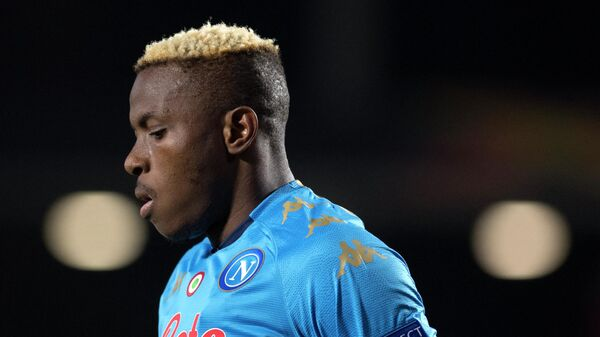 Napoli's Nigerian forward Victor Osimhen reacts during the UEFA Europa League round of 32 first leg football match between Granada FC and Napoli at Nuevo Los Carmenes stadium in Granada on February 18, 2021. (Photo by JORGE GUERRERO / AFP)