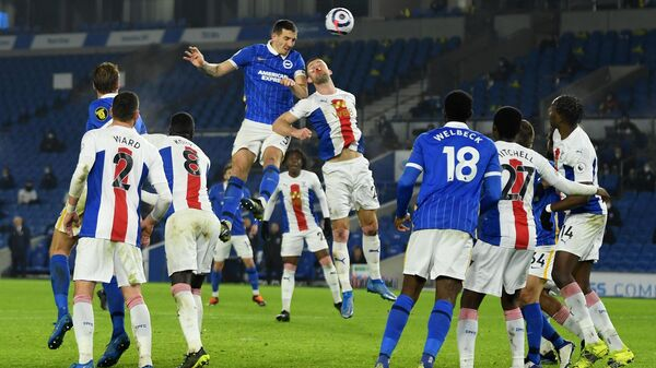 Brighton's English defender Lewis Dunk (centre L) vies with Crystal Palace's English defender Gary Cahill (C) during the English Premier League football match between Brighton and Hove Albion and Crystal Palace at the American Express Community Stadium in Brighton, southern England on February 22, 2021. (Photo by Mike Hewitt / POOL / AFP) / RESTRICTED TO EDITORIAL USE. No use with unauthorized audio, video, data, fixture lists, club/league logos or 'live' services. Online in-match use limited to 120 images. An additional 40 images may be used in extra time. No video emulation. Social media in-match use limited to 120 images. An additional 40 images may be used in extra time. No use in betting publications, games or single club/league/player publications. /