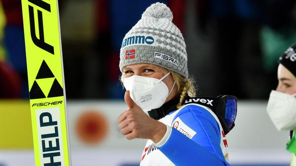 Norway's Maren Lundby give a thumbs up after winning the women's HS137 large hill jumping event at the FIS Nordic Ski World Championships in Oberstdorf, southern Germany, on March 3, 2021. (Photo by Christof Stache / AFP)