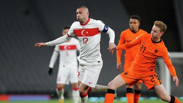 Turkey's forward Burak Yilmaz (L) is challenged by Netherlands' midfielder Frenkie De Jong during the FIFA World Cup Qatar 2022 qualification Group G football match between Turkey and The Netherlands at the Ataturk Olympic Stadium, in Istanbul, on March 24, 2021. -  (Photo by MURAD SEZER / POOL / AFP)