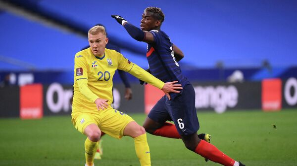 Ukraine's forward Viktor Kovalenko (L) vies with France's midfielder Paul Pogba during the FIFA World Cup Qatar 2022 qualification football match between France and Ukraine at the Stade de France in Saint-Denis, outside Paris, on March 24, 2021. (Photo by FRANCK FIFE / AFP)