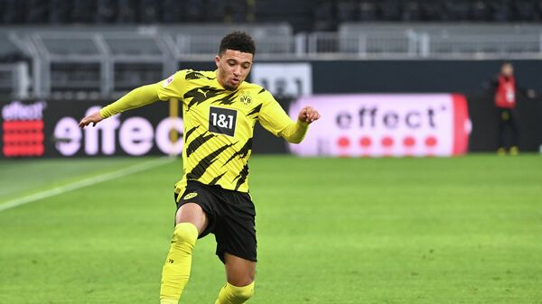 Dortmund's English midfielder Jadon Sancho plays the ball during the German first division Bundesliga football match between Borussia Dortmund and DSC Arminia Bielefeld in Dortmund, western Germany, on February 27, 2021. (Photo by Ina Fassbender / various sources / AFP) / DFL REGULATIONS PROHIBIT ANY USE OF PHOTOGRAPHS AS IMAGE SEQUENCES AND/OR QUASI-VIDEO