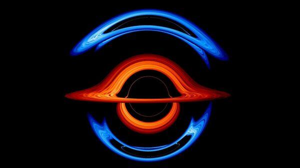 На этом кадре из новой визуализации на переднем плане находится сверхмассивная черная дыра весом 200 миллионов солнечных масс. Ее гравитация искажает свет от аккреционного диска меньшей сопутствующей черной дыры весом 100 миллионов солнечных масс. Аккреционный диск первой черной дыры показан красным, второй — синим