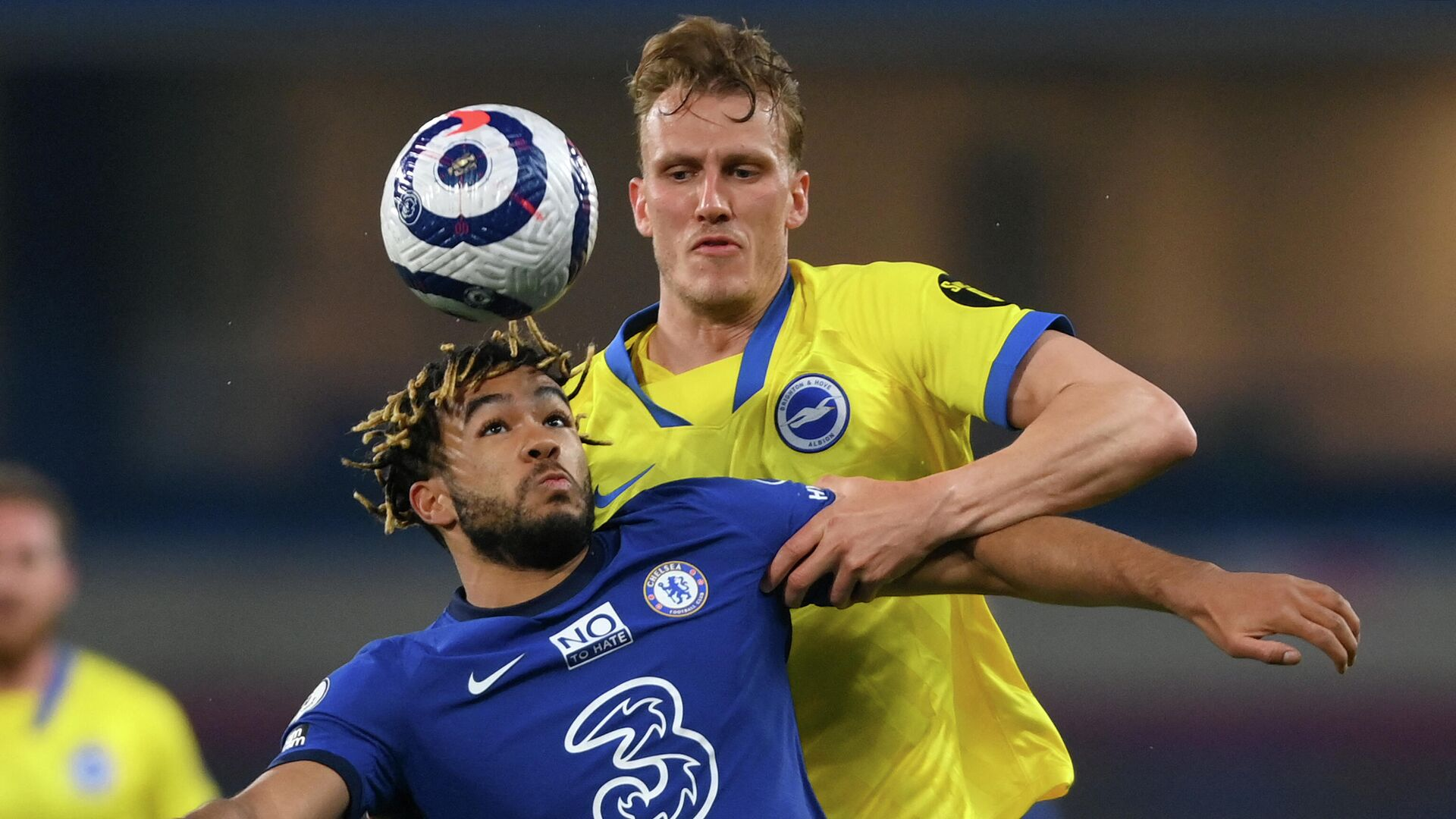 Chelsea's English defender Reece James (L) vies with Brighton's English defender Dan Burn during the English Premier League football match between Chelsea and Brighton and Hove Albion at Stamford Bridge in London on April 20, 2021. (Photo by Mike Hewitt / POOL / AFP) / RESTRICTED TO EDITORIAL USE. No use with unauthorized audio, video, data, fixture lists, club/league logos or 'live' services. Online in-match use limited to 120 images. An additional 40 images may be used in extra time. No video emulation. Social media in-match use limited to 120 images. An additional 40 images may be used in extra time. No use in betting publications, games or single club/league/player publications. /  - РИА Новости, 1920, 21.04.2021