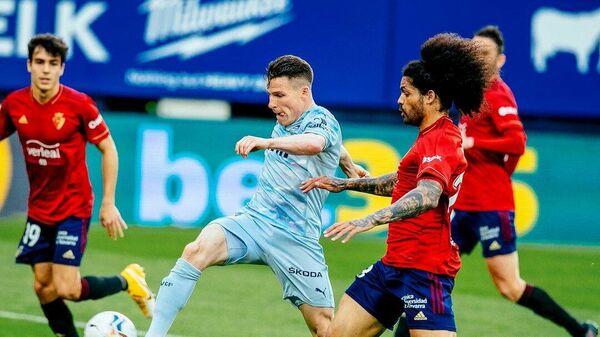 Игровой момент матча Валенсия - Осасуна