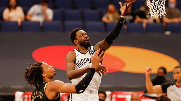 Apr 27, 2021; Tampa, Florida, USA;  Brooklyn Nets forward Jeff Green (8) drives to the basket over Toronto Raptors forward Freddie Gillespie (55) in the first half at Amalie Arena. Mandatory Credit: Nathan Ray Seebeck-USA TODAY Sports