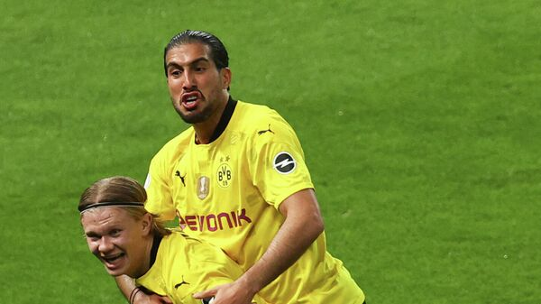 Dortmund's Norwegian forward Erling Braut Haaland celebrates scoring with Dortmund's German midfielder Emre Can during the German Cup (DFB Pokal) final football match RB Leipzig v BVB Borussia Dortmund, in Berlin on May 13, 2021. (Photo by MAJA HITIJ / POOL / AFP) / RESTRICTIONS: ACCORDING TO DFB RULES IMAGE SEQUENCES TO SIMULATE VIDEO IS NOT ALLOWED DURING MATCH TIME. MOBILE (MMS) USE IS NOT ALLOWED DURING AND FOR FURTHER TWO HOURS AFTER THE MATCH. == RESTRICTED TO EDITORIAL USE == FOR MORE INFORMATION CONTACT DFB DIRECTLY AT +49 69 67880 /